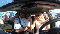 Charlotte Flair drives the pace car at the Coca-Cola 600