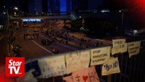 Hong Kong demonstrators defy authorities, continue protests after permit expires