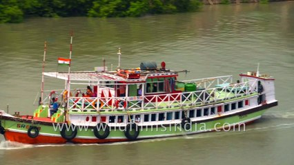 Cargo Ships and safari boats in Datta river , Sundarban, West Bengal , India, 4k stock footage