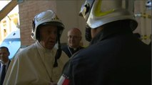 Pope Francis dons fireman's helmet to visit cathedral in Camerino