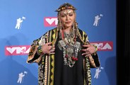 Madonna admits fame took her breath away
