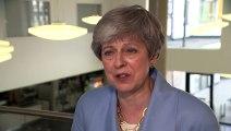 Theresa May doesn't say who she backs as next PM