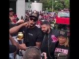 "Kawhi Leonard smoking a cigar and taking pictures with Drake wearing ""Board man Gets Paid"" Shirt at Raptors Championship Parade 6-17-19"