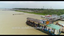 Kakdwip to Gangasagar local ferry, River Hooghly meeting the Bay Of Bengal, West Bengal, India. 4k Aerial stock Footage.