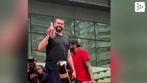 Marc Gasol drinks a bottle of wine at a drink in a shallow celebrating the Raptors winning the NBA