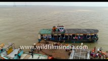 CROSSING THE RIVER HOOGHLY- Kakdwip to Gangasagar local ferry, River Hooghly meeting the Bay Of Bengal, West Bengal, India. 4k Aerial stock Footage.