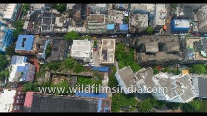 Aerial vew of Kolkata streets and buildings, from Parkstreet. 4k birds eye view, Kolkata, West Bengal, India.
