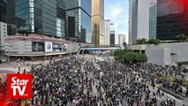 Protesters in Hong Kong press for extradition bill to be axed