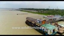 4K birds eye view , Aerial shoot of the Hooghly River meeting the Bay of Bengal, Kakdwip, Gangasagar, West Bengal, India.  Stock Footage.