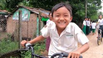 Myanmar children getting to school on recycled bike-sharing stock from Singapore and Malaysia