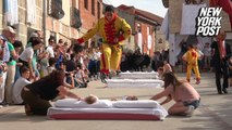 Bizarre baby-jumping festival going strong for 400 years