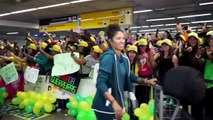(Subtitled) Brazil fans arrive in force as they congratulate their 'warriors' home from France