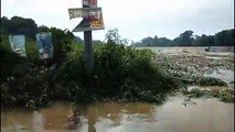Drivers stranded after swollen river floods bridge in the Philippines