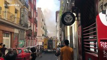 Firefighters on the scene as they attempt to extinguish flat fire in Madrid