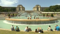 A pool with a view: tourists take dip in fountain in front of Eiffel Tower