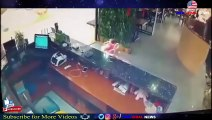 Shocking moment a baby falls down escalator in Chinese shopping mall -