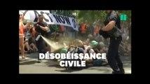 Des militants pour le climat délogés par les lacrymogènes sur un pont de Paris