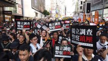 Sea of protesters march through downtown Hong Kong on July 1 handover anniversary