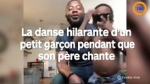 La danse hilarante d'un petit garçon pendant que son père chante