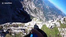 Don't look down! Base jumper glides through Austrian valley with epic wingsuit free fall