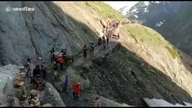 Indian officers form human shield to protect pilgrims from falling rocks