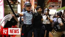 Hong Kong: Arrests made as protesters march again