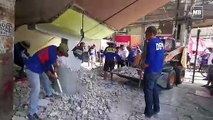 Manila City Hall's Engineering Department demolished a barangay outpost and a grotto
