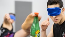 Fighting Instructor Tries The Bottle Cap Challenge