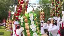 A procession of flowered crowns crosses the Portuguese city of the Knights Templar