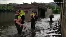 Rescuers wade through floodwaters in Spain