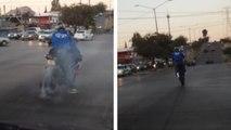 Instant karma pour un motard qui tape un gros burn à un feu rouge