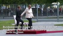 Nach Zitteranfällen: Merkel absolviert Termin im Sitzen