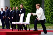 Merkel'in titremesini önlemek için sandalyeye başvuruldu