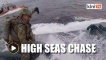 US Coast Guard crew leaps onto moving 'narco-sub'