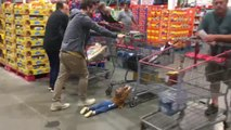 Kid Gets Dragged Along Floor While Holding Onto Shopping Cart