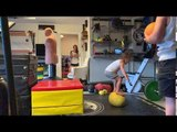 Little Boy Jumps and Lands on Medicine Ball