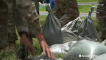 U.S. soldiers race against time bagging sandbags for Barry
