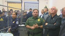 Pence confronted with nearly 400 men crammed behind caged fences in Texas
