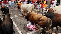Revellers dice with death in Spain's 'running of the bulls'