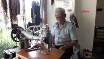 MERSİN Omzunda papağanıyla ayakkabı tamir ediyor