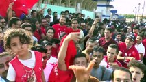 Fans gather outside the 30 June Stadium as Senegal and Tunisia meet in the AFCON semis