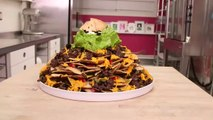 A fully loaded Nachos Cake with Cinnamon tortilla chips, chocolate and icing