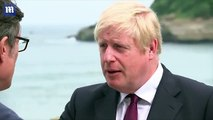 UK PM compares finding hole in a rock to finding a way through Brexit