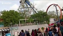 Amusement park ride crashes down in western India, killing two and injuring dozens
