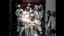 Apollo 11 astronauts wave goodbye as they head to the Saturn V rocket