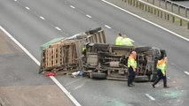 The M6 northbound is closed after a collision involving an overturned car.