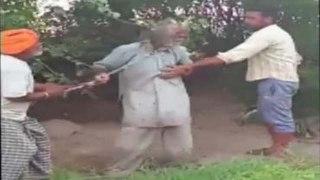 Punjab: Moga में 50 साल के बुजुर्ग को जंजीरों में बांधकर पीटा, देखें Video | वनइंडिया हिंदी
