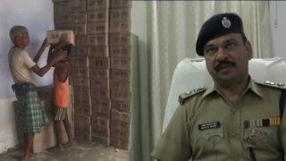 नाबालिग बच्चों से शराब की पेटियां उठवा रही पुलिस, वीडियो हुआ वायरल