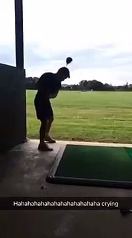 breaking the golf club slow motion