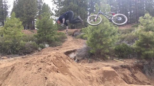Man Does Amazing Backflip off Bike on Dirt Ramp